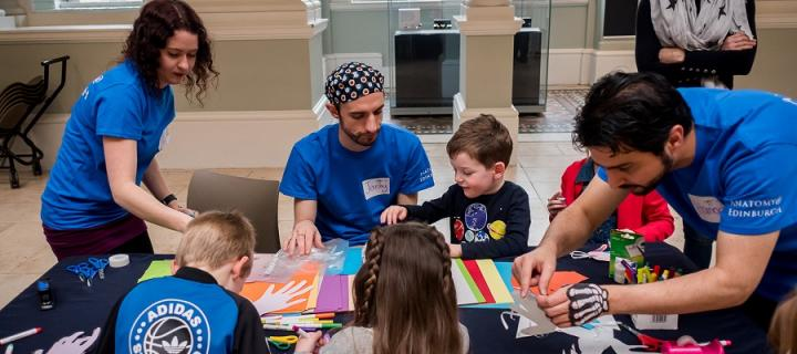 Anatomy student volunteers working with children at the Science Saturday at the Museum