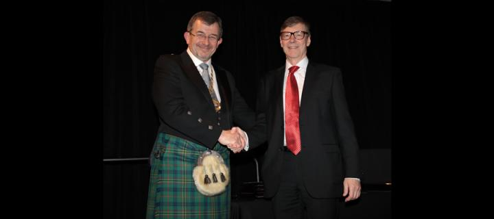 Prof Walls bearing the chain of office of President of IADR, having been inducted by his predecessor Prof Jukka Meurman
