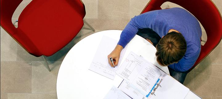 A student working on calculations.