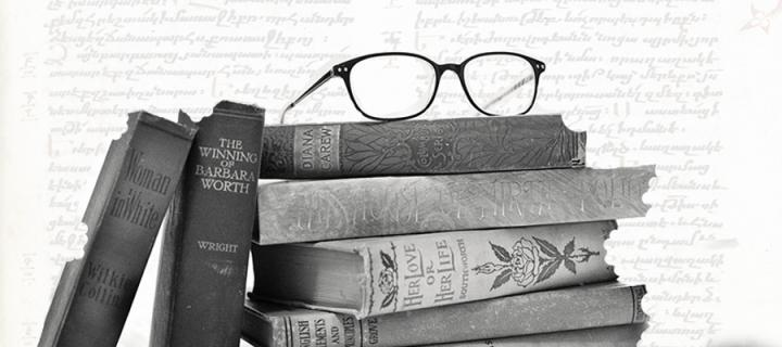 Glasses on a pile of books