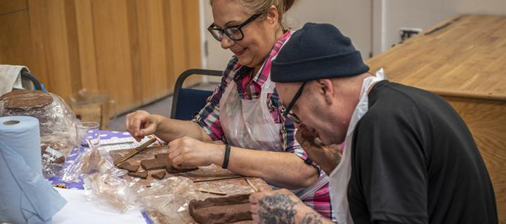 Participants respond to research by making clay models at Bodyscape