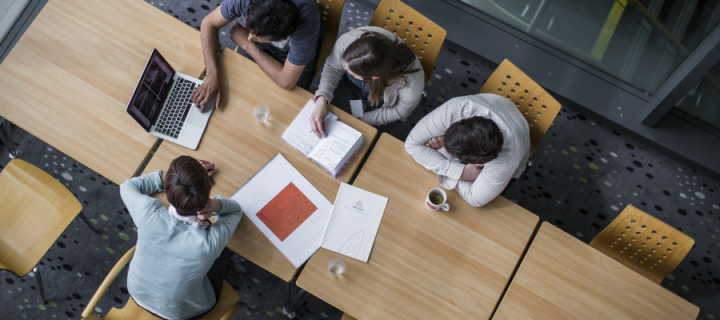Overhead image of people in a meeting