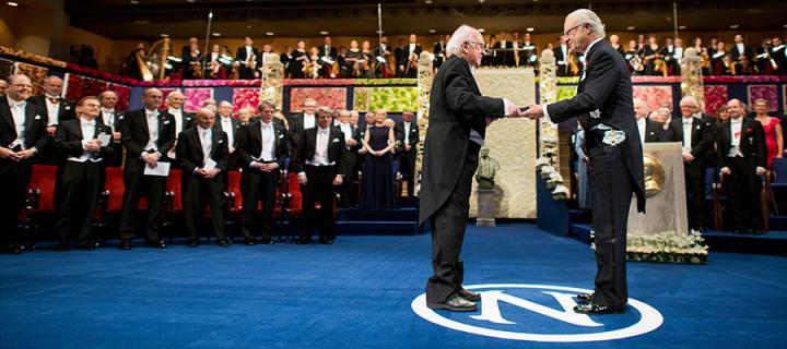 Photo of Professor Higgs receiving Nobel Prize