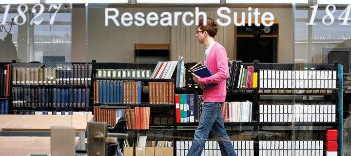 Photo of a man walking through the library's research suite