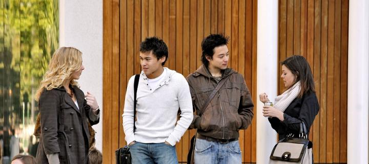 Group of international students chatting outside