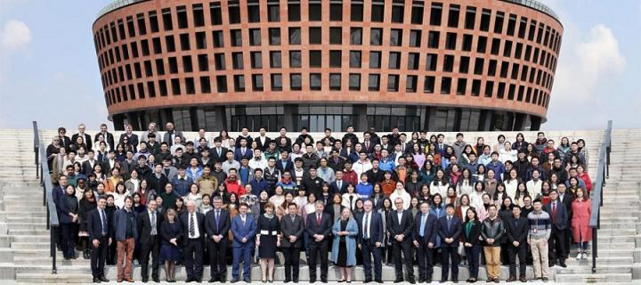 Image of all UoE and ZJE staff outside the newly opened Institute by the Principal