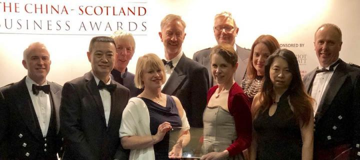 Colleagues collect the award