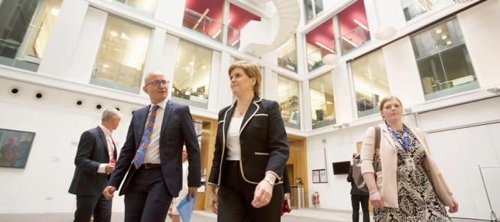 Professor Charlie Jeffery and First Minister Nicola Sturgeon walk through a building.
