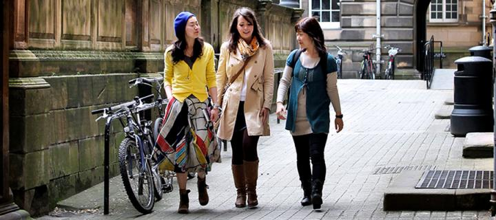 Three students walking outside the Old Medical School