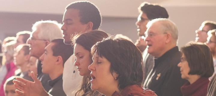 Diverse congregation praying