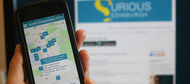 Photo of smartphone showing the Curious Edinburgh app