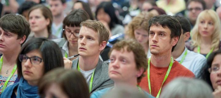 Delegates listening to a talk at a conference