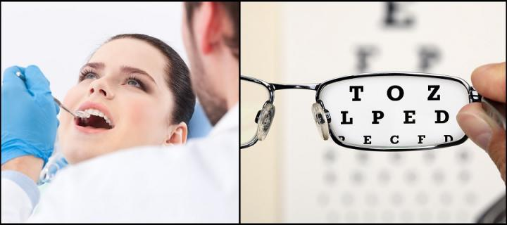 Dentist looking at mouth of patient and eye chart
