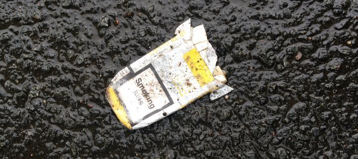 Discarded cigarette packet