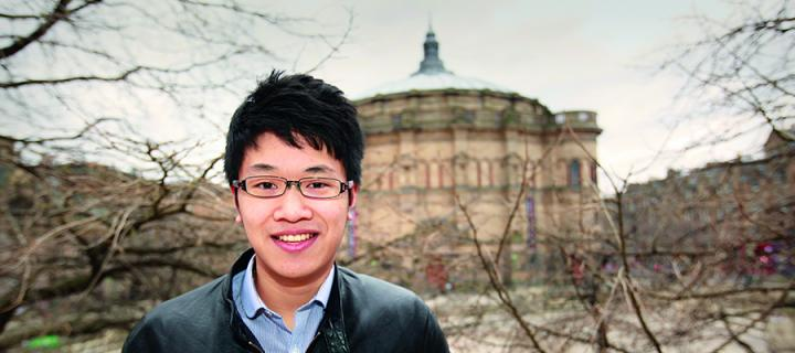 A student outside McEwan Hall