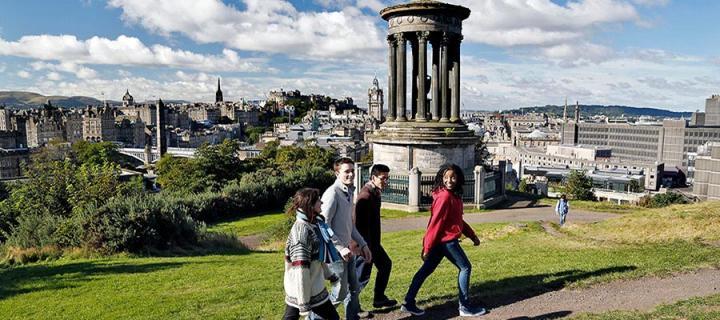 Undergraduate students on Edinburgh's Calton Hill, overlooking the city centre