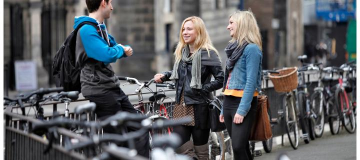 Students with bicycles chatting