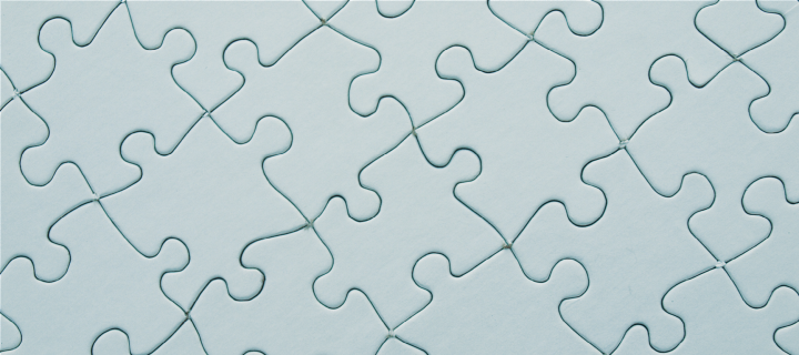 Image of a pale blue-green puzzle