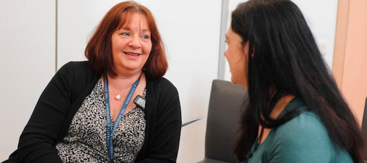 a patient in discussion with a research nurse