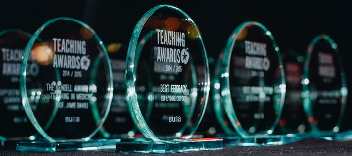 The Teaching Awards with recipients' names engraved on them.