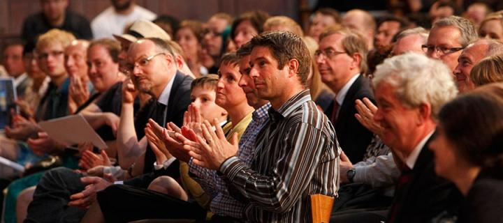 Audience applaud at a lecture