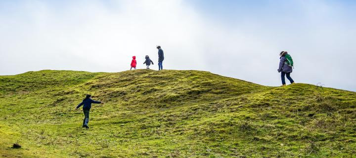 Group of people walking up Scottish hill