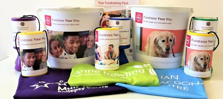 A selection of fundraising resources including branded t-shirts, collection buckets and tins.