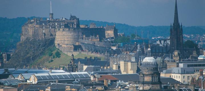 Edinburgh castle with the dome of Old College in the foreground.