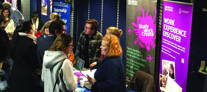 Several information stands at a careers fair in Potterrow with students and employers