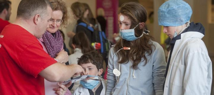 Researcher explains an experiment to a group at Edinburgh International Science Festival