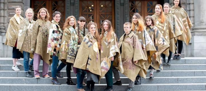 Students model their capes outside the Usher Hall.