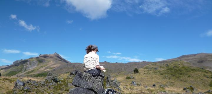 girl sitting on a volcano