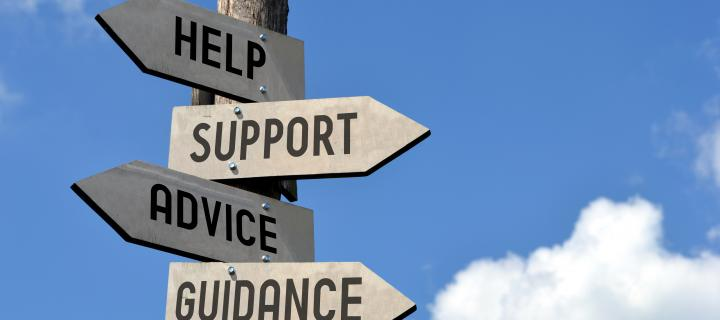 Signpost labelled help, support, advice, guidance