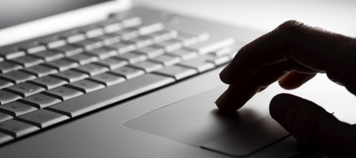Hand using keypad of a laptop