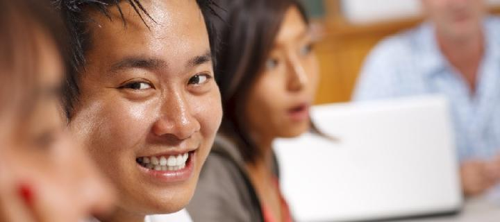 Chinese student smiling in class