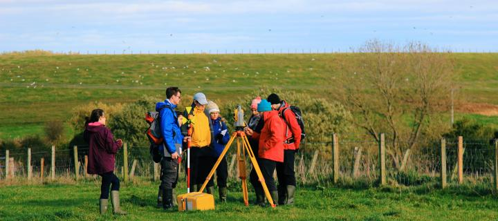 Nick Hulton teaching GIS students about the total station - GIS and Archaeology
