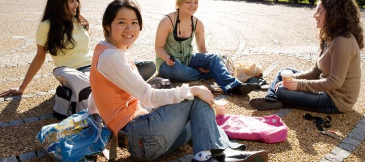 International students relaxing in the labyrinth
