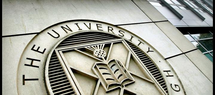 Image of University logo on building wall