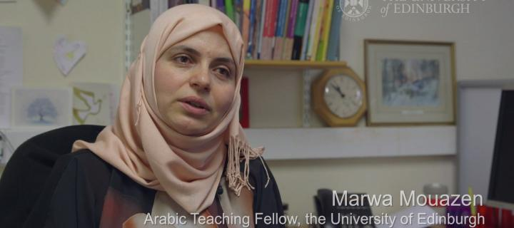 Marwa Mouazen speaking into the camera - screenshot from video