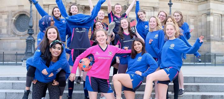 Group shot of netball club outside of McEwan Hall