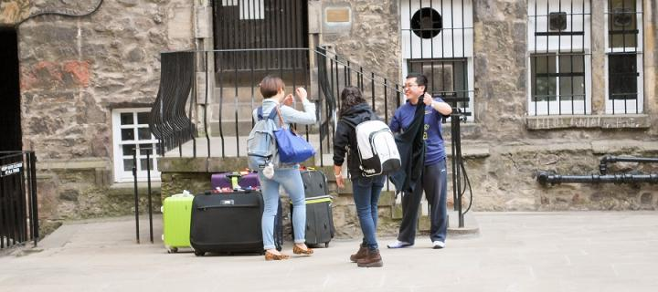 new students with luggage moving into Mylne's Court