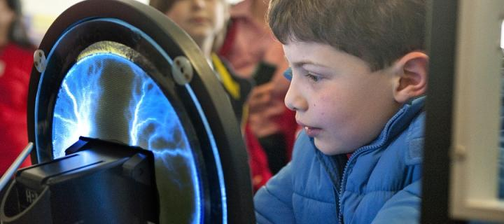 A boy looks at an exhibit at the Edinburgh Science Festival
