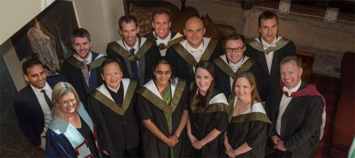 MSc Primary Dental Care students pose in their graduation robes