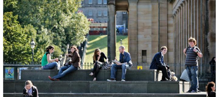 Photograph of young people sitting on the steps of the National Gallery of Scotland