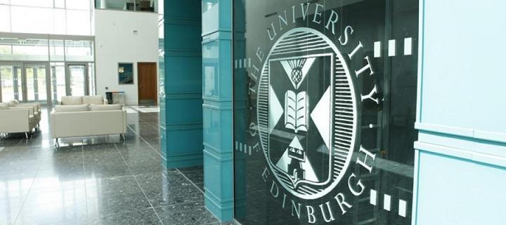 University crest on a glass door