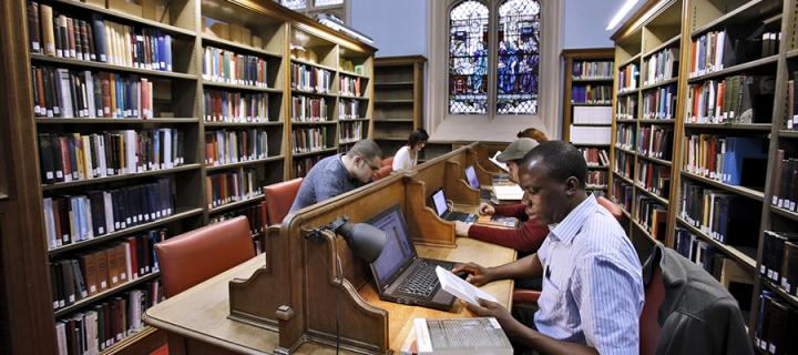 Students studying in New College library