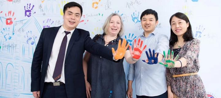 Members of the Zhejiang Institute holding up their painted hands