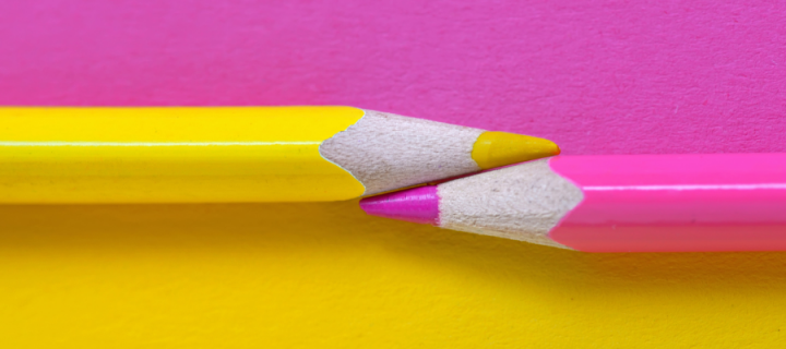 Pink and yellow pencils against a pink and  yellow background