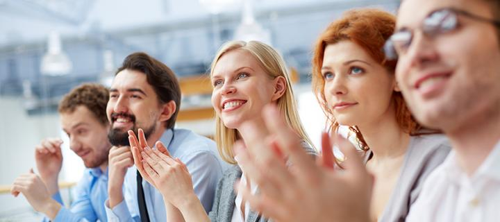 people clapping at event