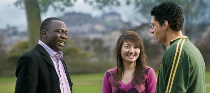 3 postgraduate students talking in the Meadows